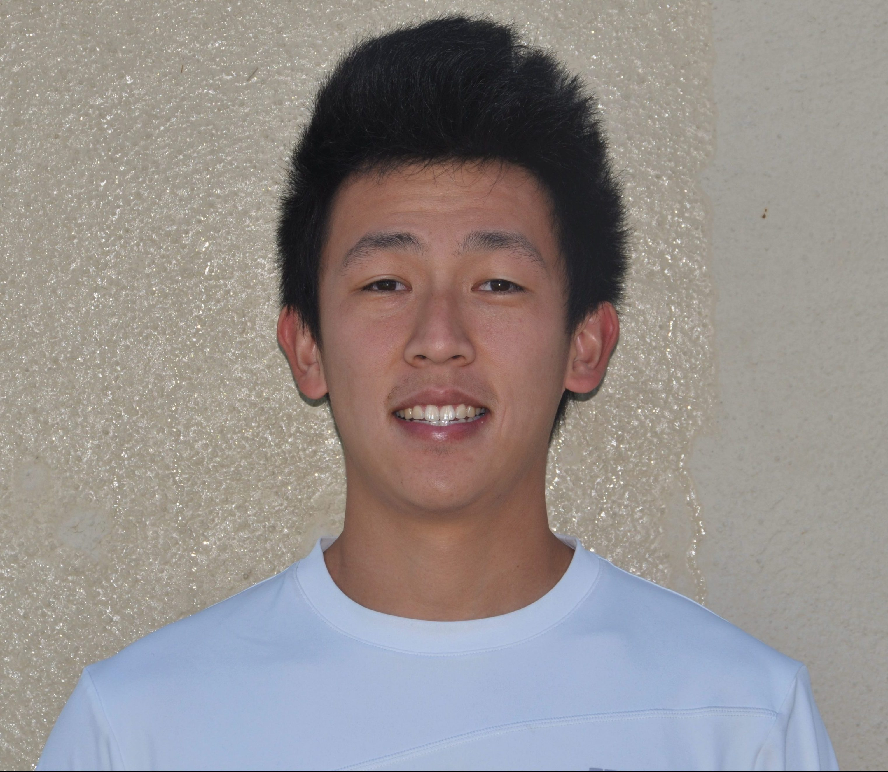 Coach James Ly at the Valter Tennis Academy